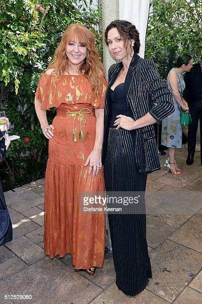 Charlotte Tilbury and actress Minnie Driver attend NETAPORTER Celebrates Women Behind The Lens at Chateau Marmont on February 26 2016 in Los Angeles...