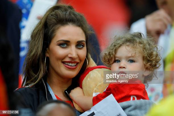 Charlotte Trippier wife of Kieran Trippier of England and their son Jacob Trippier look on during the 2018 FIFA World Cup Russia Round of 16 match...
