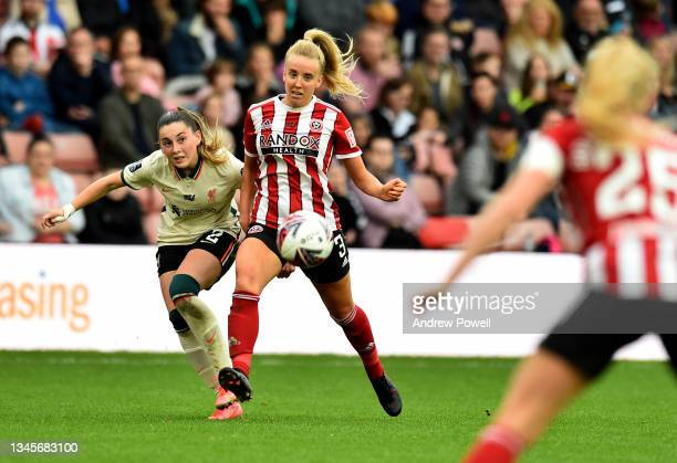 Charlotte Wardlaw of Liverpool Women competing with Charlotte Newsham of Sheffield United Women during the Barclays FA Women's Championship match...