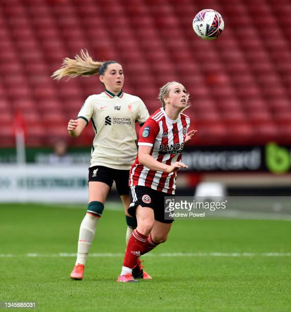 Charlotte Wardlaw of Liverpool Women competing with Rebecca Rayner of Sheffield United Women during the Barclays FA Women's Championship match...