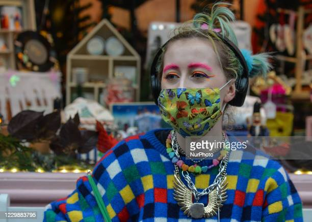 Charlotte wearing a multicolored outfit and matching face mask seen in Dublin city center. Taoiseach Micheal Martin announced last Friday plans for...