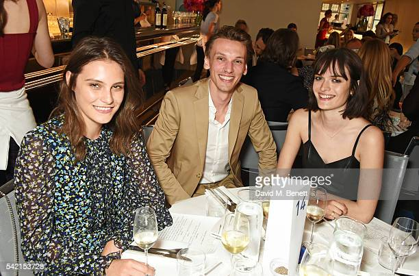 Charlotte Wiggins Jamie Campbell Bower and Sam Rollinson attend a private dinner hosted by Michael Kors to celebrate the new Regent Street Flagship...