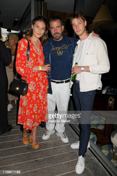 Charlotte Wiggins, Michael Maccari and Harvey James attend the Perry Ellis America pool party at Soho House Berlin to celebrate their European launch...