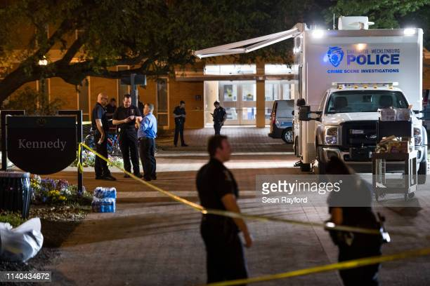 CharlotteMecklenburg crime scene investigators talk in front of the Kennedy building where a gunman killed two people and injured four students at...
