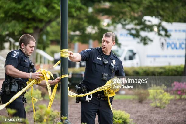 CharlotteMecklenburg law enforcement removes crime scene tape in front of the Kennedy building where a gunman killed two people and injured four...