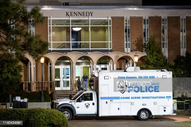 CharlotteMecklenburg law enforcement stand in front front of the Kennedy building where a gunman killed two people and injured four students at UNC...