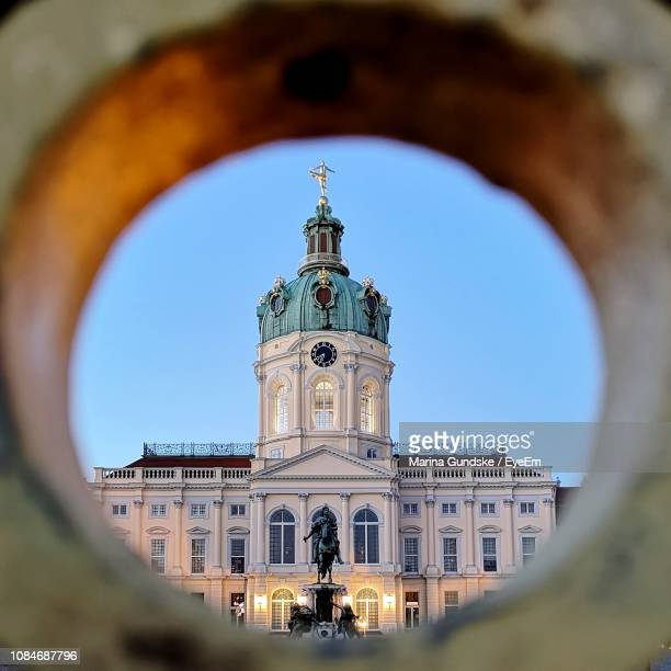 charlottenburg palace seen through hole against clear sky - charlottenburg palace stock pictures, royalty-free photos & images