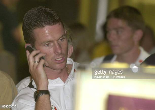 Charlton Athletic and Ireland player Mark Kinsella and Ipswich Town and Ireland player Matt Holland wait for their luggage on their return to Dublin...