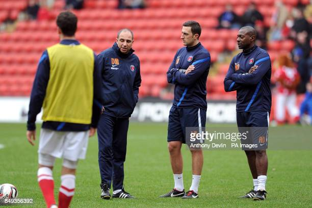 Charlton Athletic assistant manager Alex Dyer sports scientist Laurence Bloom and first team coach Damian Matthew during warmup