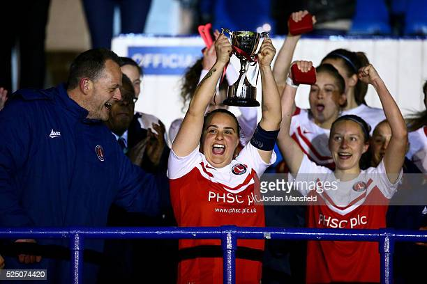 Charlton Athletic Captain Kia Dixson lifts the trophy after their victory in the Capital Womens Cup Final match between Spurs Ladies and Charlton...