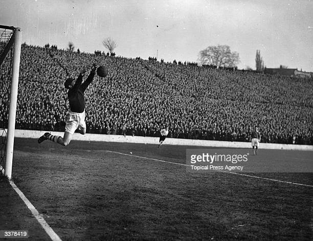 Charlton Athletic FC goalkeeper Sam Bartram makes a save as Charlton play Arsenal at the Valley ground
