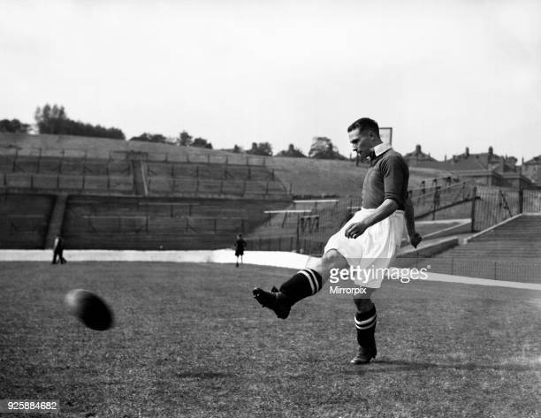 Charlton Athletic footballer George Tadman in action during a training session at The Valley, 1st September 1938.