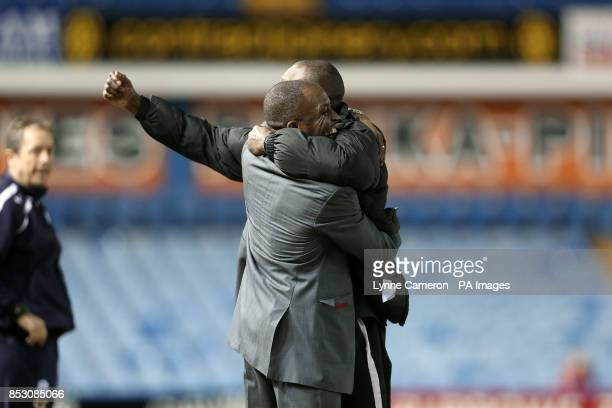 Charlton Athletic manager Chris Powell celebrates with his assistant Alex Dyer after victory over Sheffield Wednesday whose manager Stuart Grey