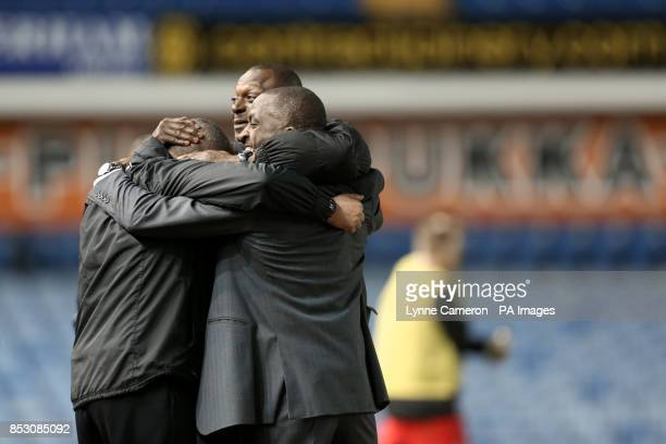 Charlton Athletic manager Chris Powell celebrates with his assistant Alex Dyer and first team coach Damian Matthew after victory over Sheffield...