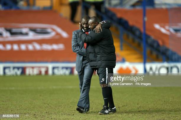 Charlton Athletic manager Chris Powell celebrates with his assistant Alex Dyer after victory over Sheffield Wednesday
