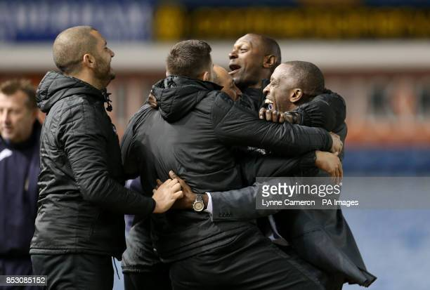 Charlton Athletic manager Chris Powell celebrates with his assistant Alex Dyer head physiotherapist Erol Umut and first team coach Damian Matthew...