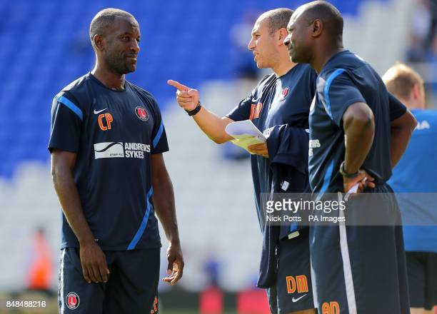 Charlton Athletic manager Chris Powell with first team coach Damian Matthew and assistant manager Alex Dyer after the final whistle