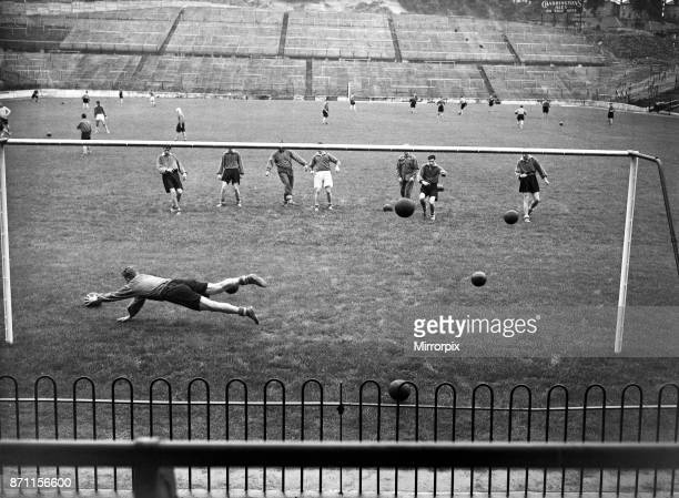 Charlton Athletic team training exercises at the Valley Shooting practice goalkeeper Sam Barttram dives to try and stop one of the many balls going...