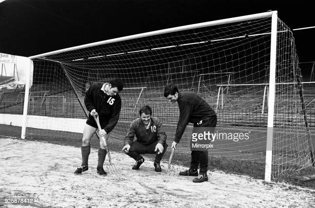 Charlton Athletic team training session at the Valley. Goalkeeper Charlie Wright directs ice clearing operations in the goalmouth as Brian Kinsey and...