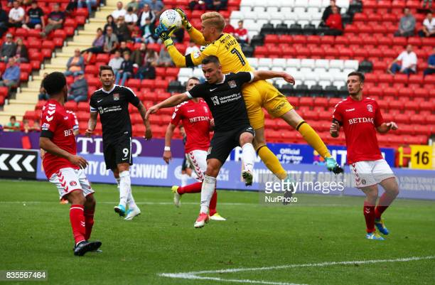 Charlton Athletic's Ben Amos and Northampton Town's Billy Waters during Sky Bet League One match between Charlton Athletic against Northampton Town...