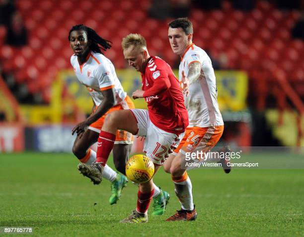Charlton Athletic's Ben Reeves holds off the challenge from Blackpool's Callum Cooke during the Sky Bet League One match between Charlton Athletic...