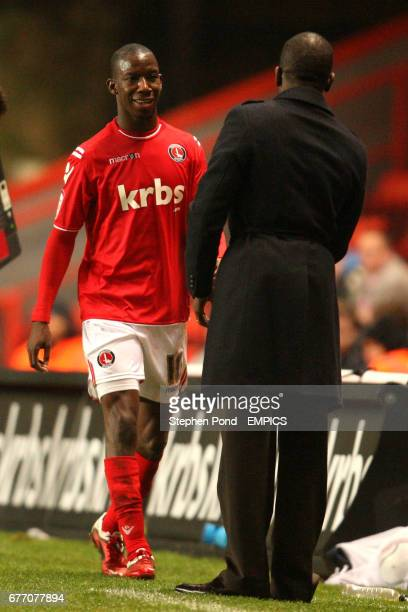 Charlton Athletic's Bradley Wright-Phillips is congratulated by manager Darren Powell on the touchline after he is substituted
