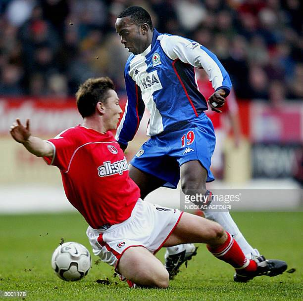 Charlton Athletic's captain Matt Holland fights for the ball with Blackburn Rovers' Dwight Yorke during their premiership match at the Valley stadium...