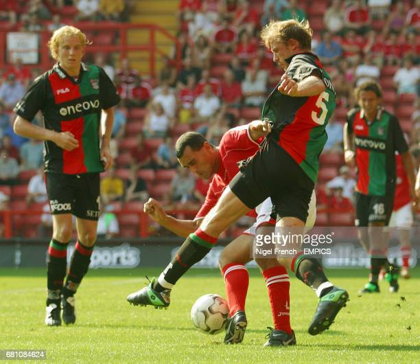Charlton Athletic's Clive Mendonca and NEC Nijmegen's Arjan Ebbinge battle for the ball