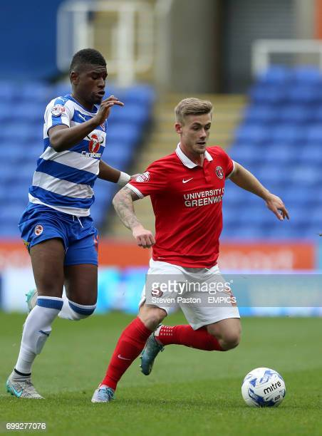 Charlton Athletic's Conor McAleny and Reading's Aaron Tshibola battle for the ball