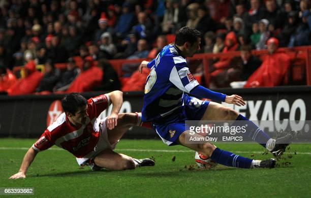 Charlton Athletic's Danny Butterfield and Doncaster Rovers's John Spicer battle for the ball