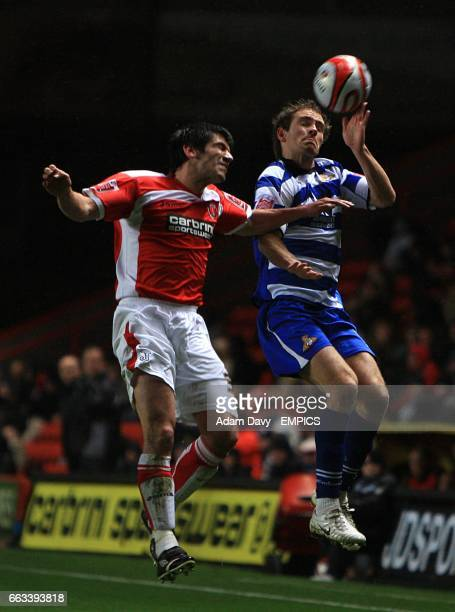 Charlton Athletic's Danny Butterfield rises high with Doncaster Rovers' Martin Woods in a battle for the ball