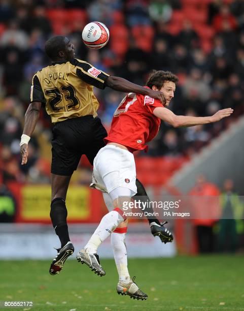 Charlton Athletic's David mooney and Milton Keynes Dons' Darren Powell battle for the ball