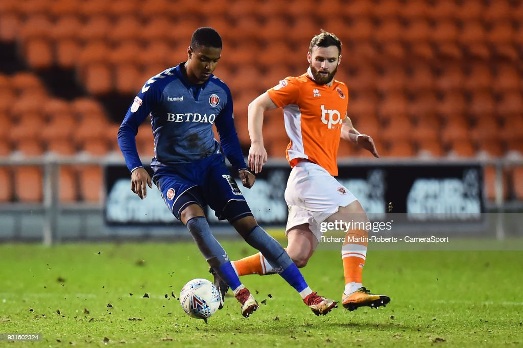 Charlton Athletic's Ezri Konsa competes with Blackpool's Jimmy Ryan during the Sky Bet League One match between Blackpool and Charlton Athletic at Bloomfield Road on March 12, 2018 in Blackpool, England.