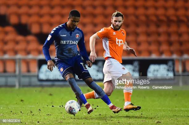 Charlton Athletic's Ezri Konsa competes with Blackpool's Jimmy Ryan during the Sky Bet League One match between Blackpool and Charlton Athletic at...