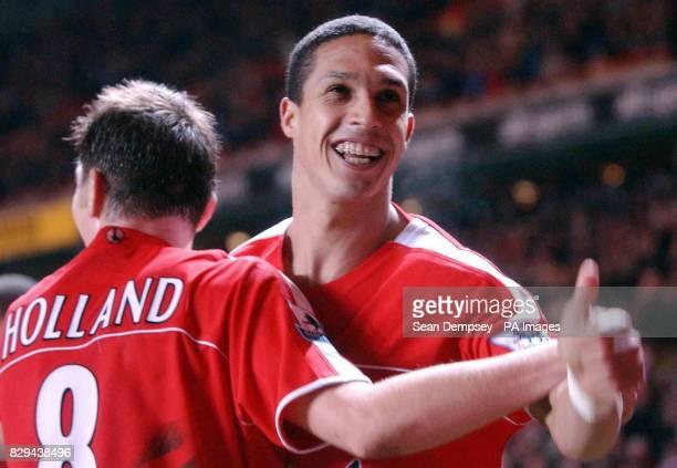 Charlton Athletic's goalscorer Talal El Karkouri is congratulated by team-mate and captain Matt Holland.