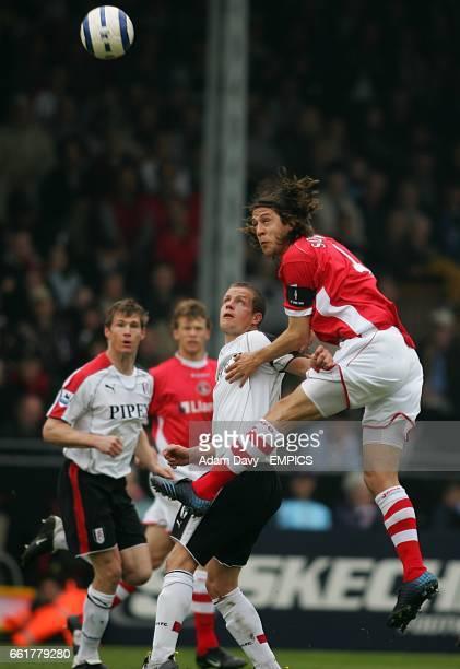 Charlton Athletic's Gonzalo Sorondo wins a header from Fulham's Heidar Helguson
