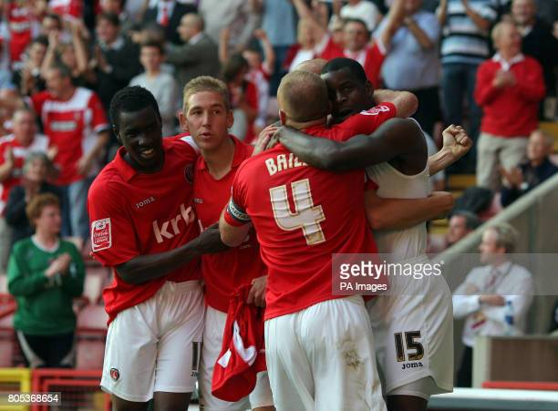 Charlton Athletic's Izale McLeod celebrates scoring the 2nd Charlton goal with teammates during the CocaCola League One match at The Valley Charlton