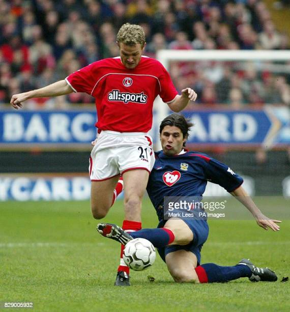 Charlton Athletic's Jonatan Johansson is tackled by Portsmouth's Dejan Stefanovic during the Barclaycard Premiership match at the Valley, Charlton....