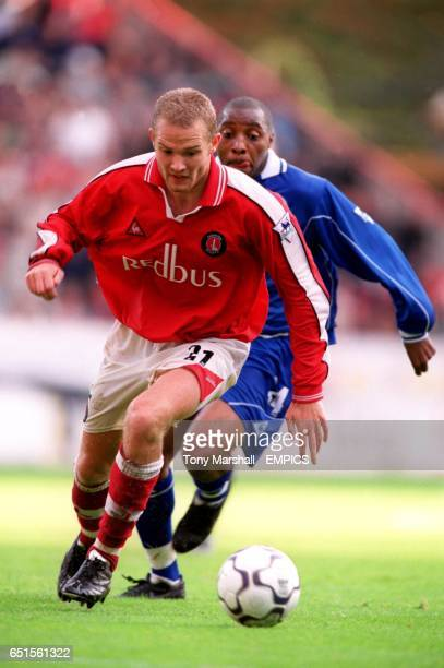 Charlton Athletic's Jonatan Johansson is tracked by Leicester City's Andy Impey