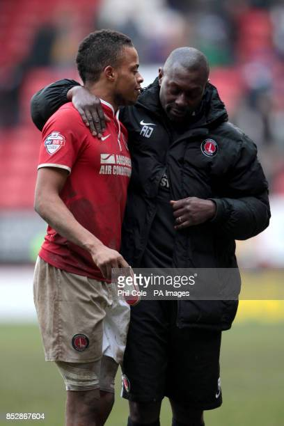 Charlton Athletic's Jordan Cousins celebrates victory with coach Alex Dyer after the final whistle