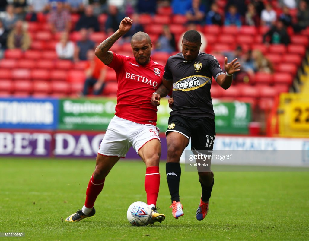 Charlton Athletic's Josh Magennis holds of Chris Humphrey of Bury during Sky Bet League One match between Charlton Athletic against Bury at The Valley Stadium London on 23 Sept 2017