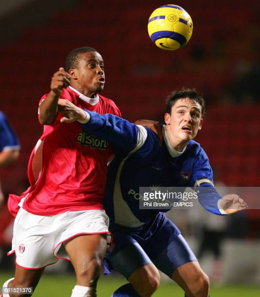 Charlton Athletic's Kevin Lisbie and Aidan Collins of Ipswich Town in action