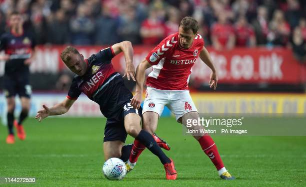 Charlton Athletic's Krystian Bielik and Doncaster Rovers' Herbie Kane battle for the ball during the Sky Bet League One Playoff Second Leg match at...