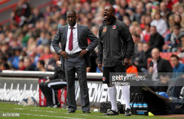 Charlton Athletic's manager Chris Powell and assistant Alex Dyer on the touchline during the npower Football League One match at the Valley London