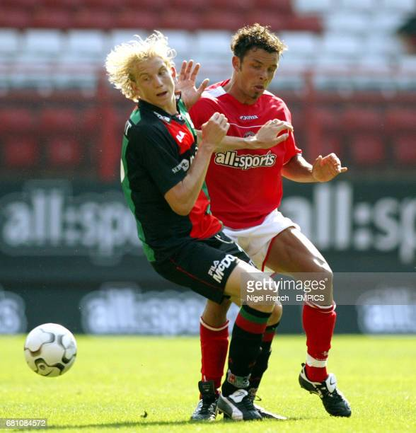 Charlton Athletic's Mark Fish and NEC Nijmegen's Frank Demouge
