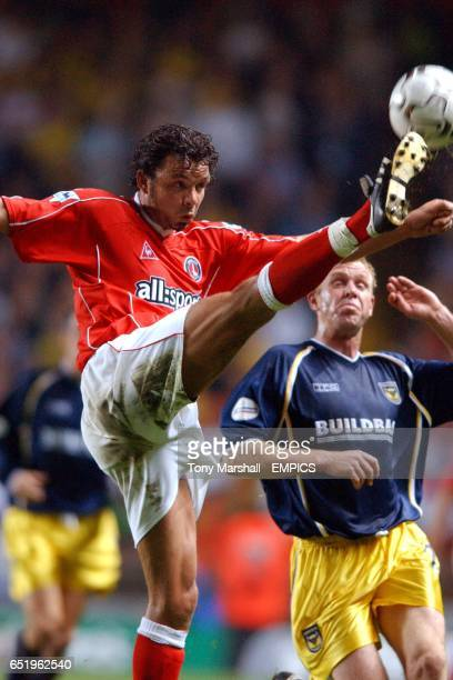 Charlton Athletic's Mark Fish clears the ball from Oxford United's David Oldfield