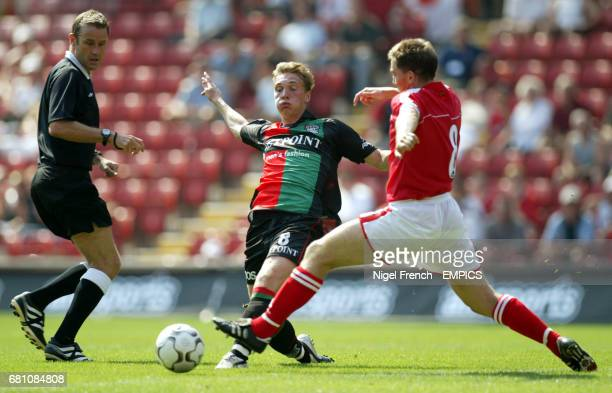 Charlton Athletic's Matt Holland tackles NEC Nijmegen's Mike Zonneveld Referee Graham Barber keeps his eye on the action