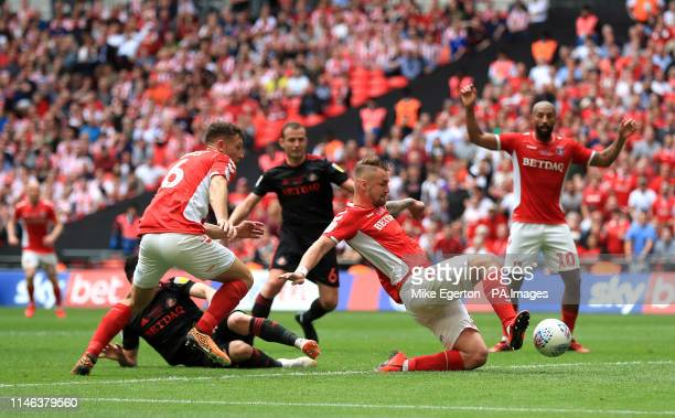 Charlton Athletic's Patrick Bauer scores his side's second goal of the game during the Sky Bet League One Play-off final at Wembley Stadium, London.