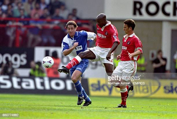 Charlton Athletic's Richard Rufus clears from Blackburn Rovers' Ashley Ward watched by Charlton Athletic captain Mark Kinsella