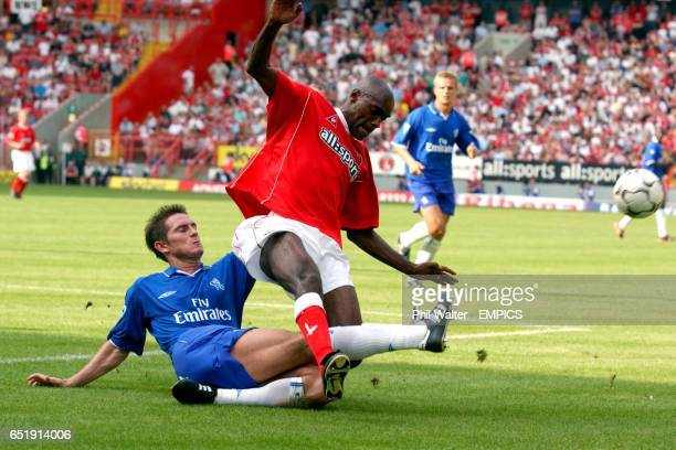 Charlton Athletic's Richard Rufus is tackled by Chelsea's Frank Lampard